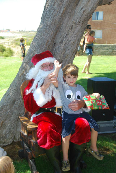 Santa giving away gifts kindly donated by Have a chat and Lancelin IGA